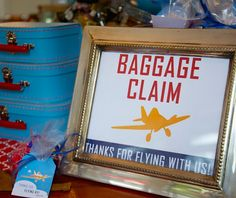 Baggage Claim signage for a planes theme birthday party- guests picked up their favors at this station