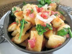 Toasted Ricotta Gnocchi with wilted Arugula and truffle oil cream
