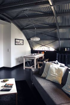 """Home belonging to Scottish graphic designer Glenn Garriock of Atelier 1A and his partner Heather is our first converted aircraft hangar. Located in Uetze, Germany, it is one of 16 hangars salvaged from the British Army by the Traditional Life Industrial Estate set up by Glenn's father and two partners in 1994."""