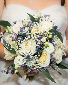 Blue and White Beautiful Bride Bouquet. Flowers by Wedding Florists, Booker Flowers and Gifts, Liverpool. #weddingflowers #blueandwhite #weddingroses #liverpoolflorist #weddingflorist