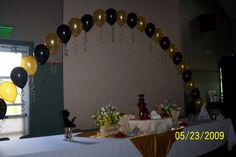 Grad party. pink, white and black balloon arch!