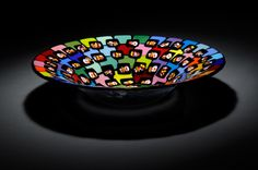 fused glass, bowl. black base with opaque colored squares topped with black squares and custom rod/bar