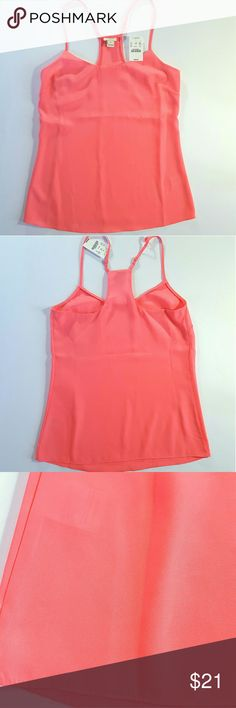 NWT J. Crew Racerback Cami Brand new! 100% polyester. A tad on the sheer side (see 4th pic, you can see where the inner tag is). This is NOT from the J. Crew factory store..their price tag is about $10 cheaper.  Light salmon pink in color. Be aware that actual color may vary slightly due to your screen settings/lighting, but I did my best to get as close to actual color as possible.   See size chart in last pic for sizing on this 00 top! J. Crew Tops Camisoles