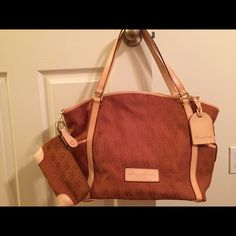 Dooney & Bourke tote. NWOT Beautiful tote, brown & veceta leather ! Never used ! Includes pouch, key fob :) Dooney & Bourke Bags