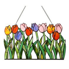 This Tulip design is constructed from a stained glass window panel and features over 150 pieces of hand cut art glass. This Tiffany-style piece will add color and warmth to any room in your home. This