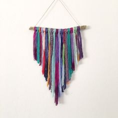 Boho wall hanging by Inspired Soul Shop. This colorful textile wall hanging was inspired by whimsical dream catchers and is the perfect dream altar for boho dec