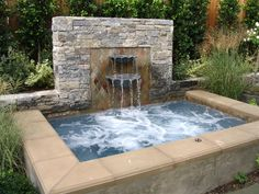 Great hot tub project with water feature! Would made a perfect DIY project. Learn more at www.custombuiltspas.com