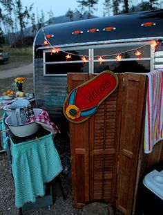 My idea of camping! There's even one with  my name on it.  Oh to have my camper look like this!
