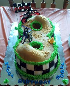Number 8 dirtbike racetrack - The birthday boy turned 8 and his mom said he wanted a dirt bike themed cake, so I incorporated his age into the cake.