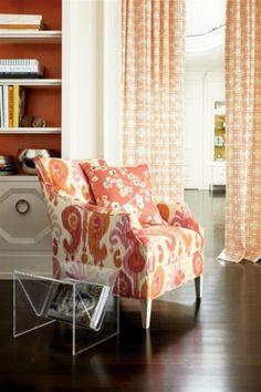 axon Chair in the fabric Journey/Fruity. Pillow in the fabric Sakura/Kumquat. Fan Pleated Draperies in the Thom Filicia fabric Citysquare/Terratone.
