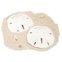 """Personalized Sand Dollar Size: 2.5""""-3"""" Minimum Purchase of 12 Be swept back in time to those lazy summer days spent strolling the beach looking for seashells with our Personalized Sand Dollar Favor. This simple, all natural sand dollar will take your breath away. The natural elegance of the sand dollar brings an air of organic beauty to any event. Have the seashell personalized and use it for any beach themed occasion. Place one of these lovely seashells at each place setting at yo..."""