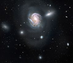 Spiral galaxy within the Coma Cluster. 320 billion light years away. Hubble Space Telescope.