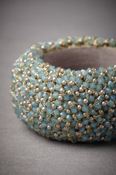 "great colors.  Swarovski ""Pacific Opal"" crystals, simulated pearls, brass.  Not high end materials but a luxe look."