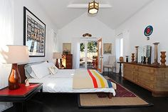 Raise ceilings in back bedroom, add doors to open to outside