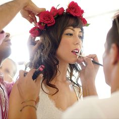 Brides.com: Hairstyles for a Destination Wedding. Wavy Wedding Hair with a Floral Crown. This bride is every bit the boho beach princess with her loosely waved locks and bright-red floral crown. Both sweet and spicy, this 'do fits right into her Mexican fiesta.  Browse more from this Mexican beach destination wedding.