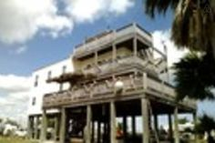House in San Leon, United States. Captains Quarters is located on Galveston bay 10 miles south of Kemah in San Leon. Located next door to Topwater  Grill and Marina, the house is fully furnished, kitchen has everything but the chef.3 levels of patio and rooftop hot tub overlooks b...
