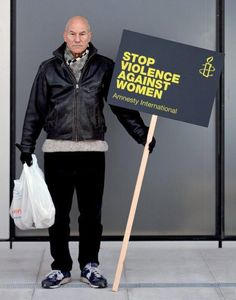 Patrick Stewart holds a sign advocating stopping violence against women. GO PATRICK!!!