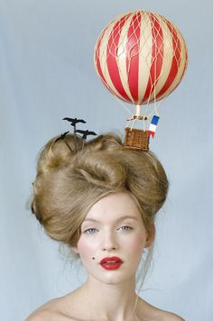perfect circus headwear. philip treacy, i believe.