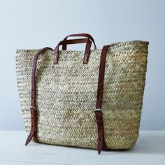 A hand-woven palm-leaf backpack with sturdy leather handles and straps. #food52