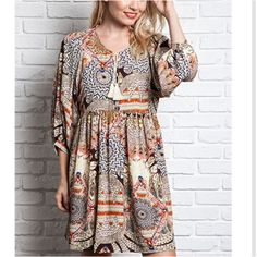 Bohemian Babydoll Dress S M L This bohemian baby doll tunic dress has an ethnic print with beautiful fall colors. Dress can be worn with or without leggings. Sizes: S M L. Comment below with size and I will create a separate listing for you to purchase. Dresses