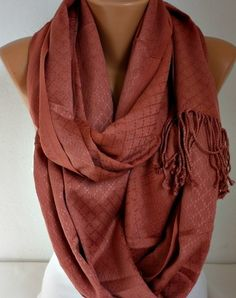 Wrap a simple scarf for a bigger look. So many different ways to wear such a simple accessory