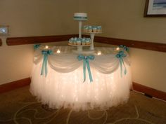 Tulle and lights under cake table - this was for a wedding or bridal shower, but it could also work beautifully for a girly baby shower or tea party. Wedding Ideias, Diy Wedding, Wedding Reception, Wedding Cakes, Dream Wedding, Wedding Day, Wedding Centerpieces, Wedding Decorations, Cake Table Decorations