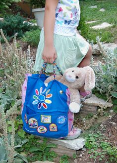 use her old girl scout Daisy vest to make a tote bag.for use as a Brownie SCOUT- That's totally a build a Bear in her case and it makes me happy... In fact I know it's the Cinnamon Bunny from 2009. How sad is that?