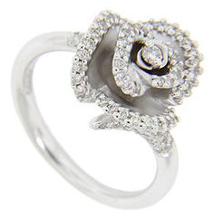Diamonds are set on the curving edges of the petals on this blooming flower 14K white gold antique style engagement ring. $1,470 on GoAntiques
