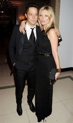 kate moss and jamie hince night out black floor length gown with belt and black clutch