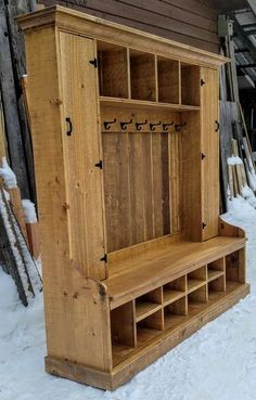 This beautifully crafted natural hall tree can be the centerpiece of any entryway. It's classic styling coupled with refined details make it a true one of a kind piece of artistry. The double lockers along with its many cubby spaces afford ample storage. It also has rustic style coat hooks that add to it functionality