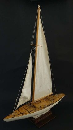 Pond Yacht with stand. Having white painted wooden hull with lead weighted keel…