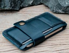 Leren iPhone hoesjes vind je bij ons! - #leather iphone 5 case black | Bravo teal leather iphone wallet by SakatanLeather on Etsy. I would have them make it in all black with a hole placed for the iPhone 5. - http://ledereniphonehoesjes.nl/slimme-iphone-6-hoesjes/