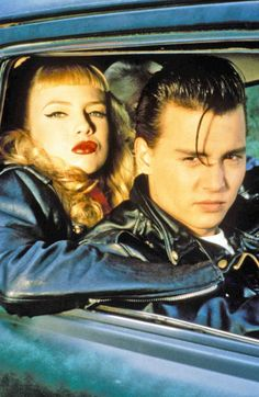 girl with a top knot. Tracy Lords and Johnny Depp.