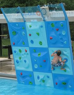 Climbing wall for the swimming pool. I like this idea way better than a slide for the pool!