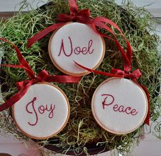 This set of 3 Christmas hoop art Christmas ornaments have been hand stitched with the words Noel, Peace and Joy. They are stitched with red DMC