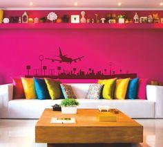 Vinilo decorativo de la silueta de un avión aterrizando en un aeropuerto.