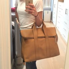 New 3.1 Phillip Lim | 31 Hour Tote Weekend Bag Never used, like new condition but please note scratches on zipper. Unfortunately, it was purchased like that from Neiman Marcus and I never noticed. Comes w/ authenticity card, orig tag, and dust bag. Nude color - really perfect for any season and outfit. Great size! NO TRADES 3.1 Phillip Lim Bags Totes