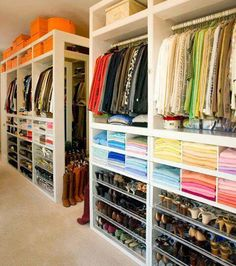 His & Hers organized closet. Great to organize by color and item type.