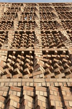 Beautiful Brickwork as Solar Screen is part of architecture - Looking like a Jenga stack on steroids, this beautiful brick facade shields the South Asian Human Rights Documentation Centre in India, doing double duty as a solar screen and noise buffer