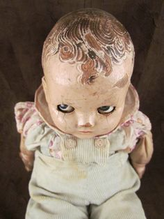 We've got a winner in the creepy doll category! Vintage Creepy Baby Doll original clothes by TheSpiralAttic, $72.00