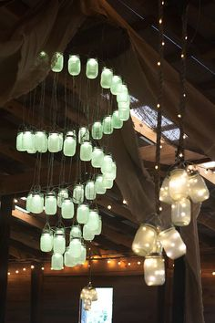 A LED mason jar light chandelier! Perfect decor for a rustic wedding. by Sarah Hearts