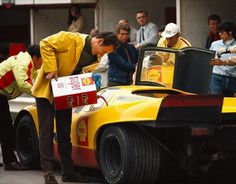 Product placement: A mechanic adds oil to the Shell-sponsored AAW Porsche 917K, 1970 Spa 1000km