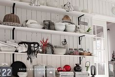 White wall and beautiful shelf for one who loves beautiful goods.