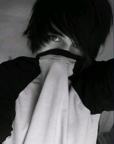 Emo boy hiding his mouth beneath his shirt...