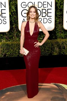 Olivia Wilde brought the heat in a custom wine-hued Michael Kors Collection halter dress and Bulgari baubles. See more of the Golden Globes' best dressed stars here!