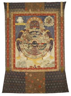 """A traditional Tibetan thangka showing the bhavacakra. This thangka was made in Eastern Tibet and is currently housed in the Birmingham Museum of Art.  Bhavachakra - Mahayana (Tibet) Buddhist depiction of """"The Wheel of Karma"""" or Samsara as represented originally by Siddhatha Gautama, The Buddha."""