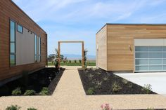 The home's recycled steel frames actually fold, which makes it possible to ship and build an entire home in under than seven months! The garage doubles as a design center, where guests can put together their own Blu Homes design.