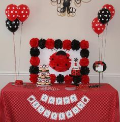 Thanks to Jennalane for sharing this great ladybug birthday party with a red, black and white polka-dots theme.