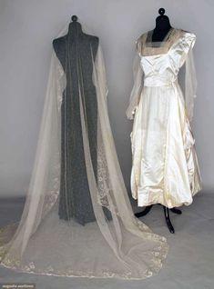 WEDDING GOWN & VEIL, 1914, Candlelight satin, Pt de Gaz lace trim, net veil w/ princess lace, blue garters, wax flowers, silk stockings, 3 lace hankies.