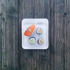 Minimal sushi on a wooden background - Foodie's Feed